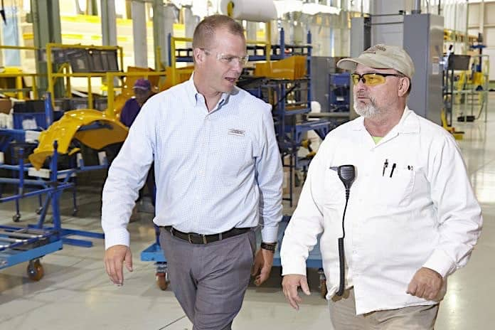 Caley Edgerly, left, walks the Thomas Built Buses Saf-T-Liner C2 plant with employee Jimmy Trivette.