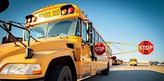 A school bus with an extended stop arm.