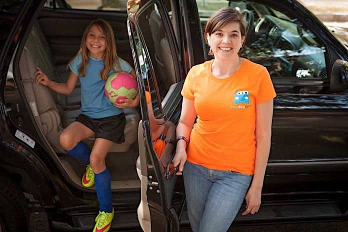 A HopSkipDrive employee with a student.