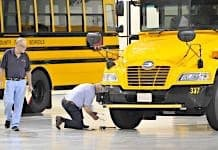 A participant inspects a tire during the 2015 America's Best School Bus Inspection Skills & Training Competition in Kansas City. Photo By Mike Bullman.