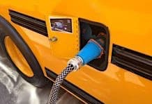 A electric school bus being charged. Interest in electric is expanding across the U.S.