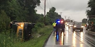 An overturned Delaware school bus.