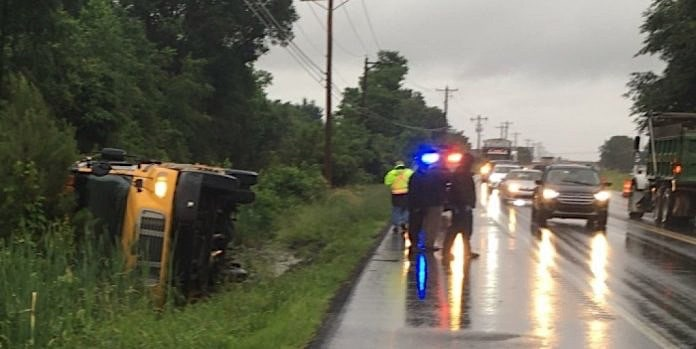 An overturned Delaware school bus.