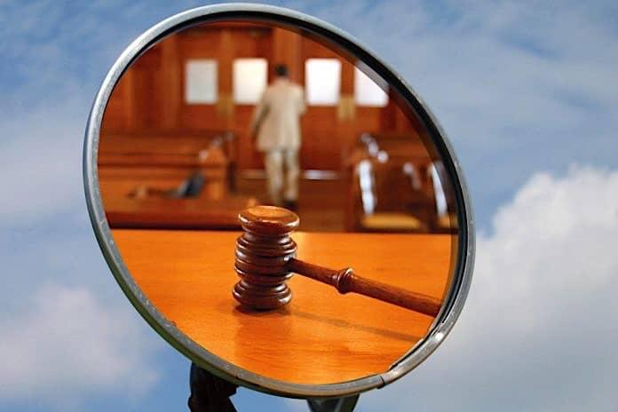 Courtroom scene in school bus mirror