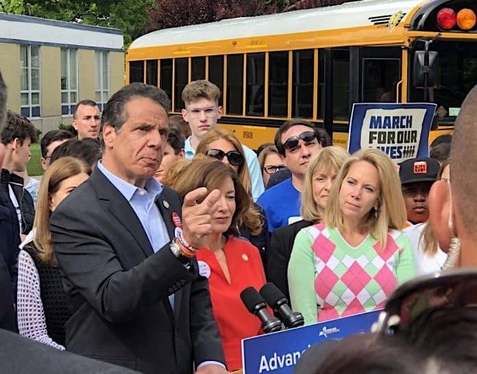 New York Gov. Andrew Cuomo and other officials rode a school bus to a press conference on Monday, June 11, 2018 to promote new legislation to improve student safety at schools.