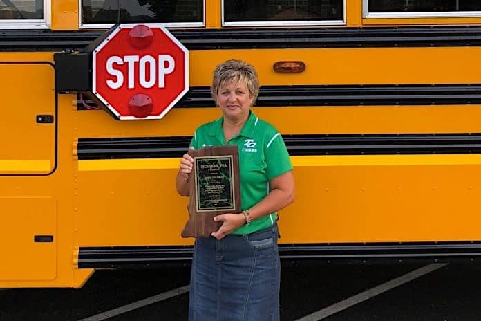 Susie Childress poses with Richard Pea Award.