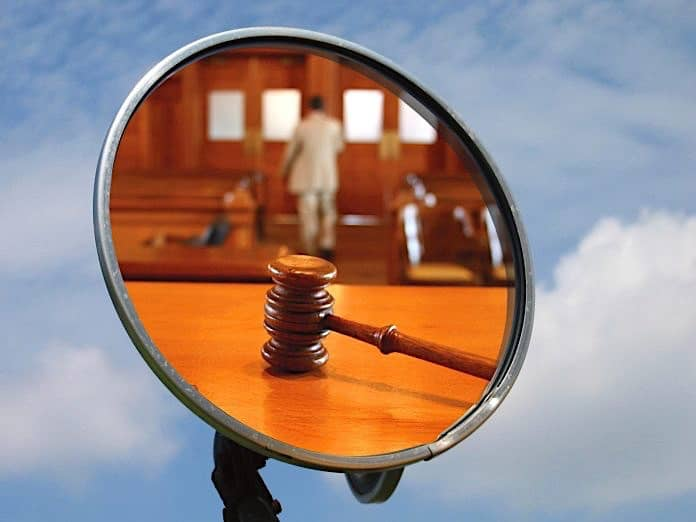 gavel in bus mirror