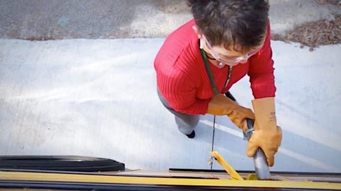 Driver fueling propane school bus