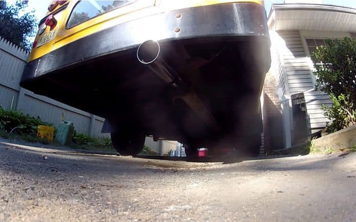 Exhaust coming from a school bus tailpipe.