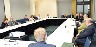 ABA School Bus Council members sit around table.