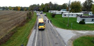 Photo from the NTSB report on State Route 25 in the aftermath of three siblings being hit and killed by a motorist who illegally passed the stopped school bus in rural Rochester County, Indiana. (Source: Fulton County Sheriff's Office.)