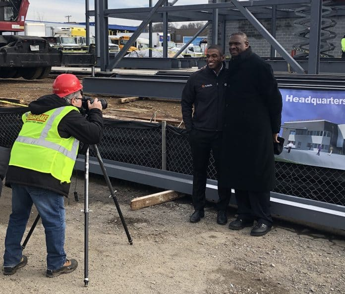 The father-son duo of Korey and Stephen Neal stand in front of the construction site of their new facility in Maryland.