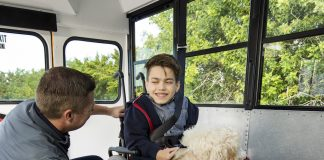Service animal on a school bus - image courtesy of Q'TRAINT/Sure-Lok.