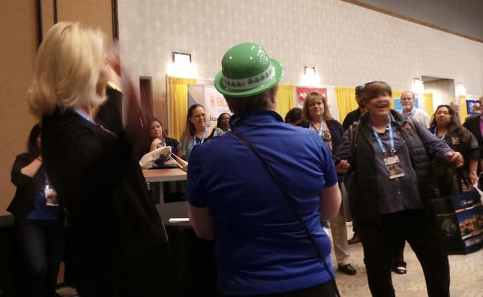 A happy contest winner celebrates sweet victory in the first drawing at the TSD trade show. Photo by David George.