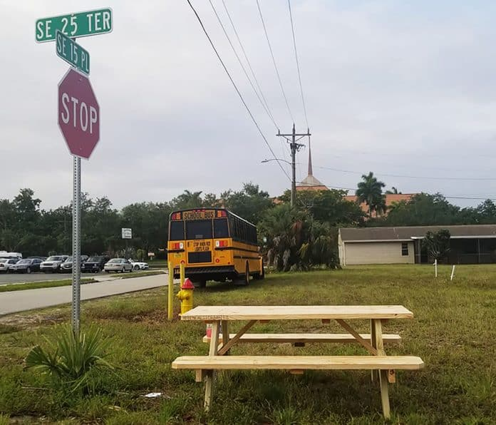 "The nonprofit organization ""Benches for our Babes"" was launched in Lee County, Florida, after recent student deaths. Over the past several weeks, community members have assembled to make and place benches at bus stops, to improve bus stop safety. (Photo courtesy of Sara J. Gummerman.)"