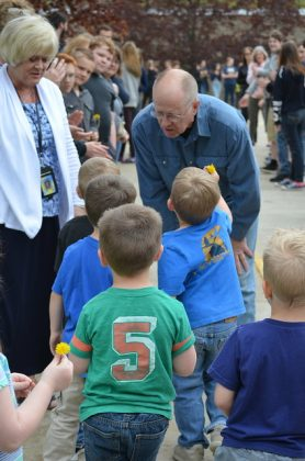 Torpey speaks with students who congratulate him for saving the life of a mother along his route.
