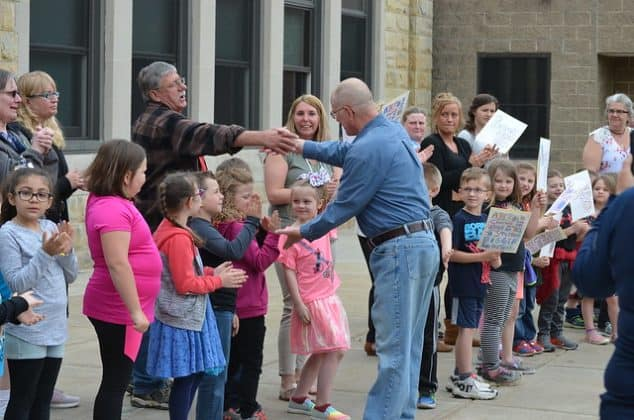 Torpey receives congratulations from school staff as well as students.