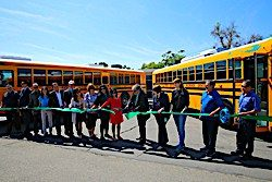 School district officials, community members, Air Quality Management officials and partner representatives gather to partake in the ribbon cutting celebration at Twin Rivers Unified School District.