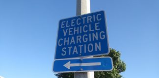 Sign showing direction of closest electric charging station.