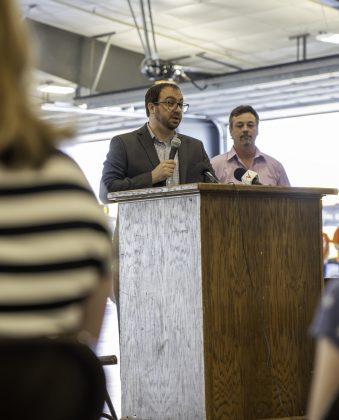 Ben Fladhammer speaking a podium.