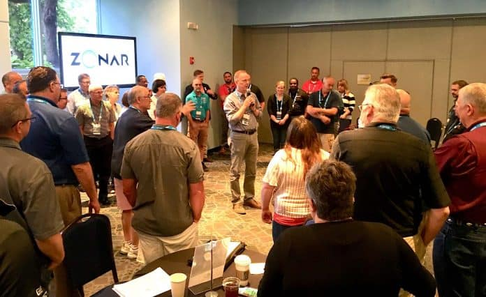 Don Harkey instructs attendees on how to play the