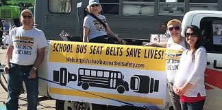 The School Bus Safety Alliance designed a colorful banner to help campaign for seat belts in school buses, at the Avon Lake Memorial Day Parade in Ohio. (Photo courtesy of cleveland.com.)