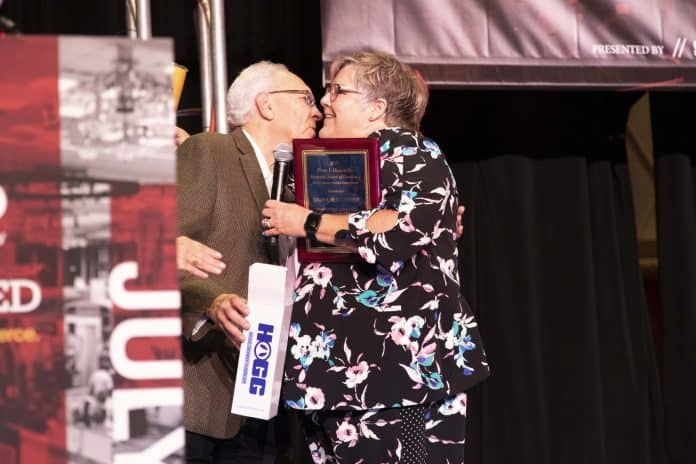 Bud Fears presents the 2019 Peter Grandolfo Award to Diana Hollander at the STN EXPO Reno on July 28, 2019.