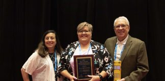 Diana Hollander (center) won the Peter Grandolfo award for 2019. Hollander is pictured in the middle with Linda Grandolfo (left) and Bud Fears of sponsor Q'Straint.