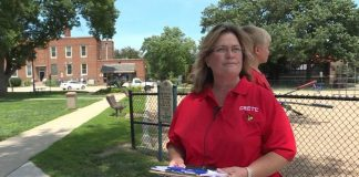 Crete Public Schools mom Mishelle Kortus, with her petition. (Photo courtesy of 1011 Now News.)