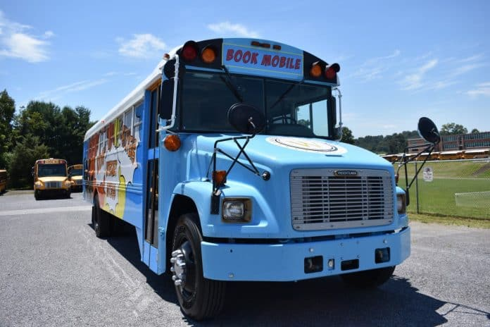 Washington County's refurbished school bus gives students access to reading during the summer. (Photo courtesy of Herald & Tribune.)