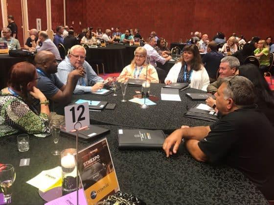 TD Summit attendees converse.