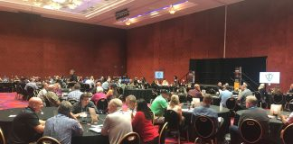 Over 100 attendees and representatives discuss their inspiration during the opening of the Transportation Director Summit on Friday, July 26, 2019.
