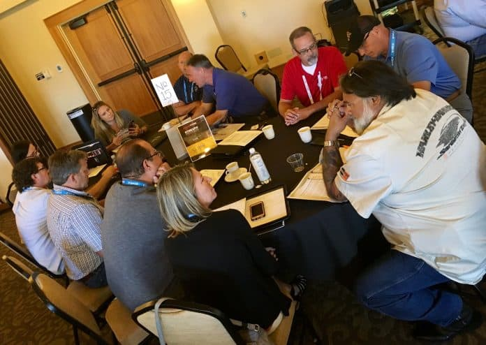 A table at the 2019 Transportation Director Summit at STN EXPO Reno is deep in discussion.