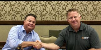 The new National School Transportation Association president (left), John Benish, Jr. (Cook-Illinois Corp.) assumed office this week from outgoing president Blake Krapf (Krapf School Buses)(right), at NSTA's 2019 annual meeting and convention.