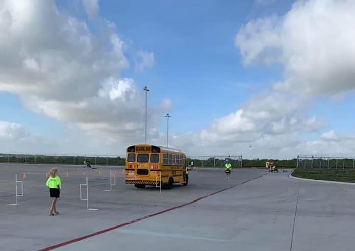 School bus driving a rigorous road course