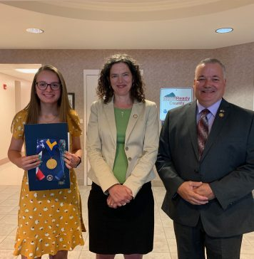 Sen. Jen Metzger, center, awarded the New York State Liberty Medal to 14-year-old Rachel Trimbell. Trimbell, left. Also pictured is Delaware County Sheriff Craig DuMond, who presented another award to Trimbell in May.