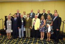 Front row, left to right: Sue Kramer, Brad Krapf, Dale Krapf, Gary Krapf, Dallas Krapf, Alison Sload, Beverly Peppernick, Blake Krapf. Back row left to right, Brent Cumens, Alison Bryant, Dan Jauch, Dennis Ryan, Shawn McGlinchey, Jim Hager, Stacey Golden.