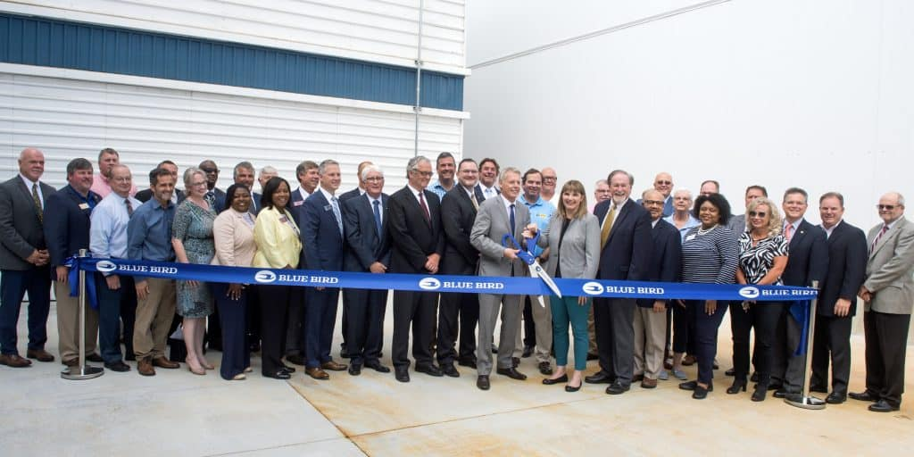 Blue Bird employees, dignitaries, dealers and contractors, at the new paint facility.