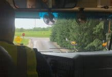 inside of school bus, looking over school bus driver's shoulder