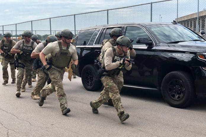 SWAT officers prepare to storm a school bus in a response to a mock hijacking at the NSTA Annual Conference & Convention on Monday, July 22, 2019 in Austin, Texas.