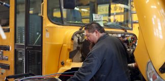 A Twin Rivers Unified School District mechanic performs AC checks and diagnostics.