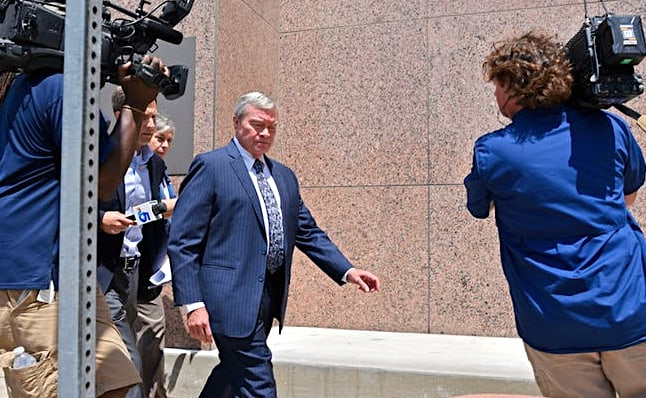 Rick Sorrells, the ex-superintendent of Dallas County Schools, exiting the federal courthouse in Dallas. He was sentenced to seven years in federal prison. (Photo capture from Dallasnews.com.)