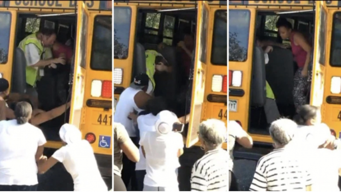 A student's mother fights with a school bus employee on Sept. 19, 2019. (Photo courtesy of CBS Denver.)