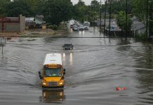 A school bus driving through flooded roads on Sept. 19 in Houston. Hurricane Imelda reportedly dumped 40 inches of rain in over 72 hours. (Photo: Thomas B. Shea/Getty Images.)
