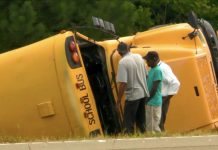 A school bus in Mississippi drove off the road and rolled several times. The school bus driver died and seven students were injured on Sept. 10, 2019. Photo courtesy of CBS News.
