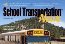 Greg Jackson of Jefferson County Schools poses with a Blue Bird School Bus
