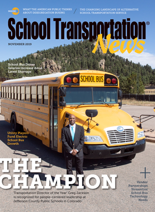 Greg Jackson of Jefferson County Schools poses with a Blue Bird School Bus