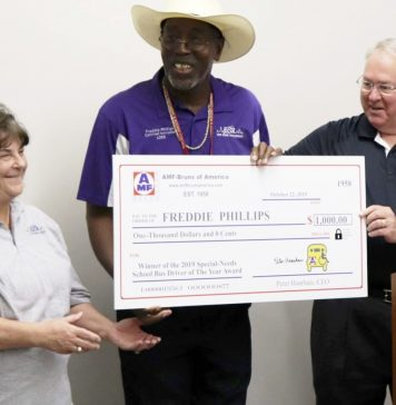 Special needs driver Freddie Phillips received this year's AMF-Bruns 2nd annual National Special-Needs School Bus Driver of the Year Award. Steve Barker (right), sales manager of AMF-Bruns presented Phillips with a check, along with Donna Broussard-Martin (left), transportation supervisor for East Baton Rouge Parish Schools.