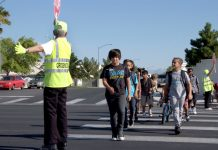 Clark County School District students crossing the street with the help of a crossing guard. (Photo courtesy of CCSD.)