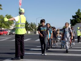 Clark County School District students in Las Vegas cross the street with the help of a crossing guard. (Photo courtesy of CCSD.)